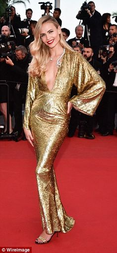 Liquid gold: Natasha Poly slipped into a form-fittingcustom Michael Kors gown with a plun...