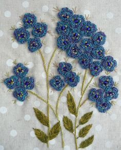 Forget-me-not (Myosotis)  - Embroidery with crocheted flowers! This is so lovely!