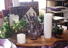 Using purple and cream colored dishes in a traditional yet rustic style table.