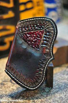 Really enjoy the work of Steve B. He takes it to the next level... The Inner Secret Fin Wallet by stevebleatherworks on Etsy, $225.00