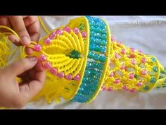 Easy Macrame Jhumar with new design Macrame Toran Designs, Macrame Design, Macrame Art, Jhumar, Wind Chimes Craft, Easy Crochet Hat, Macrame Wall Hanging Patterns, Diwali Craft, Diy Flowers