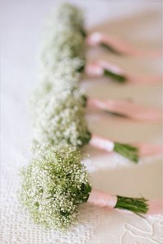 babys breath bouquets for bridesmaids with blush pink ribbon