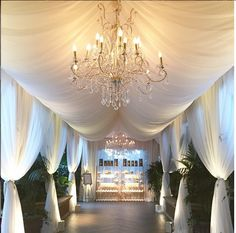 | aboutdetailsdetails.com | white drapes, luxury wedding entry, wedding hallway, crystal chandeliers, all white wedding, stunning hallway