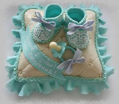 #Cute #baby #shoe #on #a #pillow #cake