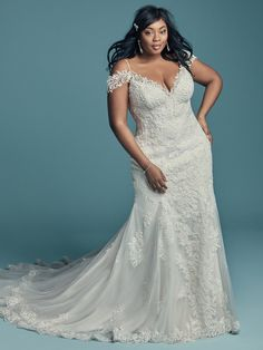 Truly timeless, because flirty + flattering looks good in any era. This plus-size mermaid wedding gown is tailored to perfection.  Beaded lace motifs and Swarovski crystals over tulle  Beaded Lace Bodice  Slight illusion scalloped back neckline with raised lining for more coverage  Lined plunging sweetheart neckline  Beaded spaghetti straps and attached cold-shoulder sleeves accented in lace motifs easily removable to fit bride's preference  Covered buttons over zipper closure  Also… Plus Wedding Dresses, Lace Wedding Dress, Fit And Flare Wedding Dress, Plus Size Wedding, Perfect Wedding Dress, Bridal Dresses, Modest Wedding, Party Dresses, Summer Dresses