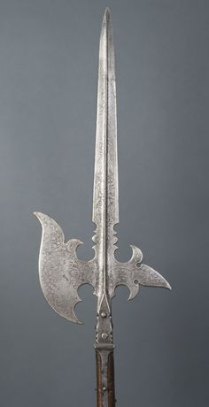 State Halberd for the Trabanten Guard of Ernst of Bavaria, Prince Archbishop and Elector of Cologne  Blade etched by Master VS. Shaft made by Master MC.  Geography: Made in Germany, Europe Date: 1594