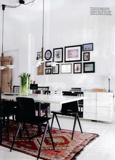 In love with this simple dual purpose (dinning room / office table) room. The white washed wood floors and walls, accents of black and natural wood in the furniture and accessories, on top of a traditional Kilim rug is the perfect mix of modern and antique. [ look at the light fixtures and chairs!!!]