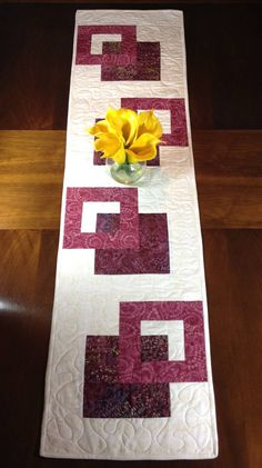 Quilted Tablerunner in Cream and Wine, Modern Batik Table Runner, Handmade Reversible Table Quilt, Contemporary Marsala Dining Decor ----------------------------------------- Although designed as a modern look table runner, this quilt could also be used to adorn your wall, a dresser, coffee table, sofa table, buffet, desk, bed or piano top. The wine / plum / Marsala / burgundy and cream color scheme is versatile and can be used in any season. A layer of batting enclosed betwee...