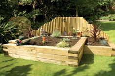 By using raised sleepers, you can set specific zones for your planting, whether it be flowers or vegetables, keeping everything nice and neat.  #raised #garden #beds