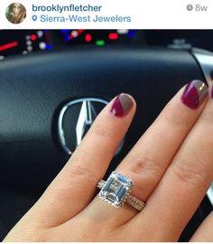 emerald shaped diamond. shoulder halo. white gold. engagement ring.
