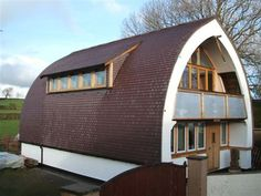 Engineer Modernizes The Traditional Cruck Frame With Modern Framing and Straw Bale, detailed plans and description