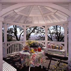 Open-Air Gazebo - A white wooden lath roof like this one offers an open, airy option for a gazebo.