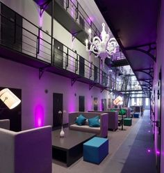 Here's Het Arresthuis, a jail-themed hotel. Located in Roermond, The Netherlands, the hotel is actually a luxury offering, swanked up with purple lighting and chandeliers.