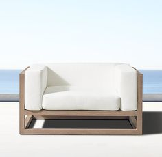 "RH's Aviara Lounge Chair:Artisan Barlas Baylar brings modern élan to his first collection for the outdoors. Crafted of the finest sustainably harvested, premium teak, Aviara's linear, framed openings create a highly architectural silhouette. The design's perfect proportions and crisp cushions provide a refined counterpoint. WATCH THE FILM ""AN ARCHITECTURAL NATURE"" FEATURING BARLAS BAYLAR ▸"
