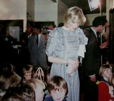 25 March 1983 Princess Diana and Prince Charles meet the firefighters of a recent bushfire at Cockatoo,Australia.