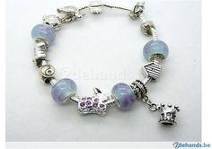 Armband met lichtblauwe/zilveren bedels en kroontje - Te koop