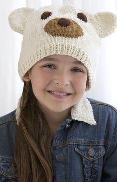 Easy appliqued pieces turn this simple knit cap into a happy polar bear, sure to keep your favorite child warm and snug.