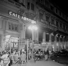 A night view as patrons sit outside Cafe Armonia and Hotel Coruna in Montevideo, Uruguay.