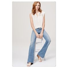 "LOFT Button Fly Flare Jeans Worn once and washed in cold water, hung to dry. In a classic light indigo wash, our flare jeans are our widest leg shape, mid-rise with a slim fit through the hip and thigh. Button fly. Belt loops. Five-pocket styling. Contrast topstitching. 32 1/2"" inseam. 92% COTTON, 7% POLYESTER, 1% ELASTANE LOFT Jeans Flare & Wide Leg"