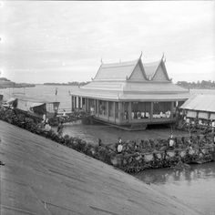 """King's Floating House, Phnom Penh."" King's Floating House was moored on the river opposite the Royal Palace, along Sothearos Quay, and was where he (most likely King Sisowath or King Monivong) watched the water sports and boat races held in November each year. #PhnomPenh"