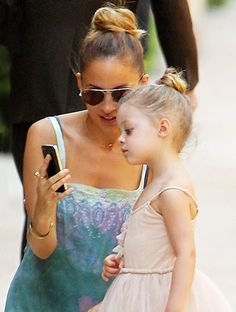 Nicole Richie wear ray ban sunglasses and daughter Harlow with matching ballerina buns.