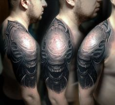 Alien movie creature tattooed on arm; Giger influence.