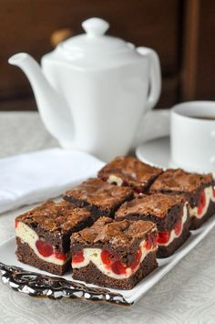 An outstanding soft chewy brownie with a cheesecake centre that gets sweet glacé cherries baked into it. Another great freezer friendly cookie bar recipe. cheesecake Cherry Cheesecake Brownies - two tempting favourites in one! Brownie Recipes, Cheesecake Recipes, Dessert Recipes, Nutella Recipes, Dessert Blog, Chewy Brownies, Cheesecake Brownies, Christmas Desserts, Christmas Baking