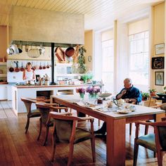 Terence Conran house, modern, rustic, kitchen, country, island, natural, white, copper, relaxed, dining table, wood, tile; Photograph by Paul Massey via Living Etc