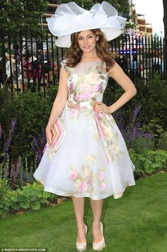 Fabulous in florals: Model Kelly Brook arrives at the final day of Royal Ascot in a Jacques Azagury dress and Philip Treacy hat