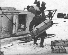 Unloading ammunition boxes from an NKL-16 aerosan.