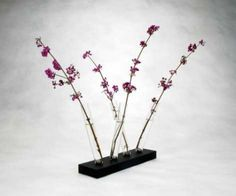table centerpiece with flowers in glass test tubes