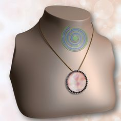 Sunrise interchangeable Xpression on small pendant base. Pink mother of pearl with black czs.  shop online and use discount code Joyofgifting to get 25% off your purchase. Valid until Jan 1,2015.