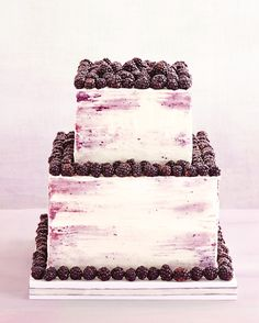 Blackberries can serve as sweet accents and double to help create a marbleized frosting effect fit for a backyard wedding or a ballroom reception. This blackberry and whipped-cream cake from Jason Schreiber exemplifies the ever-popular and not to mention sustainable, farm-to-(dessert) table cuisine.