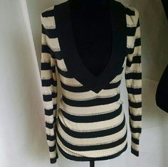 Express black and gold sparkle sweater Express XS beautiful black and cream sweater with gold sparkle deep v-neck Express Sweaters V-Necks