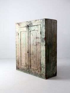 circa late This is an American wood cabinet. The primitive cabinet features a two door opening. The interior has a four shelves. The doors latch closed with a little metal pulls, and a small woo Primitive Cabinets, Primitive Furniture, Primitive Kitchen, Old Furniture, Country Furniture, Bedroom Furniture Sets, Country Primitive, Primitive Decor, Painted Furniture