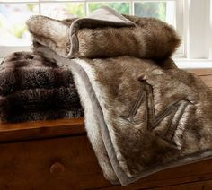 Just saw these faux fur blankets at Pottery Barn and can't stop thinking about it. Want one!!