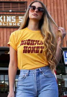 We've got those road vibes. Our Highway Honey tee is printed on inspired, marigold yellow tees, with burgundy and brown print. Unisex sizing, meaning a looser women's fit. We suggest women order Womens Vintage Tees, T Shirt Vintage, Vintage T-shirts, Vintage Style, 70s Fashion, Denim Fashion, Vintage Fashion, Fashion Outfits, Fashion Stores