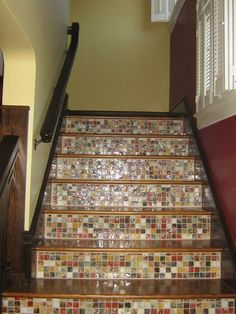 Again, probably not my exact colors, but I like the small tiles, wood and the contrasting colors from within the tiles in this stairwell.