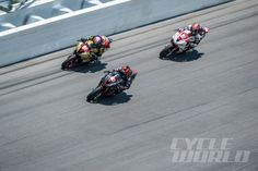 Dane Westby, Jason DiSalvo and Danny Eslick on the DIS banking during the 2014 Daytona 200