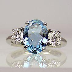 Oval aquamarine & two brilliant cut diamonds