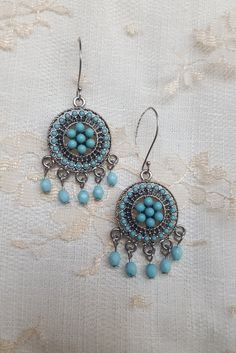 A personal favorite from my Etsy shop https://www.etsy.com/listing/468537472/turquoise-bohemien-earrings