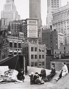 On the rooftop of Agnes Martin's studio building, Coenties Slip, 1957. Left to right: Delphine Seyrig, Duncan Youngerman, Robert Clark [Robert Indiana], Ellsworth Kelly, Jack Youngerman, and Agnes Martin. (photo: Hans Namuth)