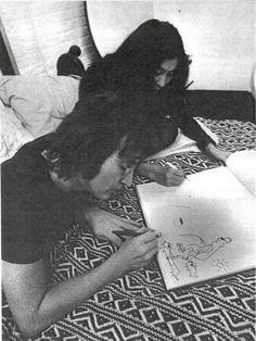 John Lennon drawing with Yoko