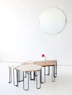The Bradford table plays to the theme of individual pieces that can be grouped as a whole. Prices range from $610 for the triangular wood-topped table to $1,290 for the stone hexagon; the bases are blackened steel.