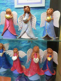 """3rd grade ceramic angel sculptures, approx. 10"""" ---12"""" in height; lesson by art teacher: Susan Joe"""