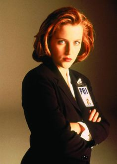 Dana Scully. I wish I watched X-Files when I was kid. What a great role model for girls!