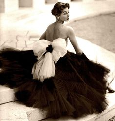 Vintage-Retro in the 40's showcased enormous skirting & bows...to accentuate the silhouette......& frame flawless skin & great bone structure.......today......this same aesthetic is again trending.
