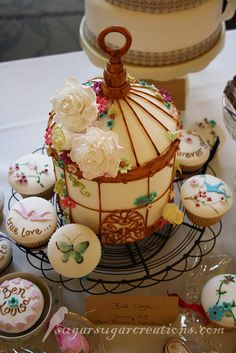 """This Beautiful Bird Cage Cake with painted cupcakes are so Romantic! Perfect for a Ladies Tea, a Lunchen, a Bridal Shower or a Whimsical Valentine Celebration without the typical """"hearts 'n roses""""."""