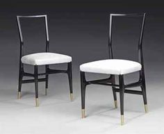 GIO PONTI (1891-1979) PAIR OF CHAIRS, CIRCA 1950 produced by Cassina, lacquered ebonised wood, brass sabots and upholstery 34 in. (86 cm.) high; 15¾ in. (40 cm.) wide; 17 in. (43.2 cm.) deep (2)