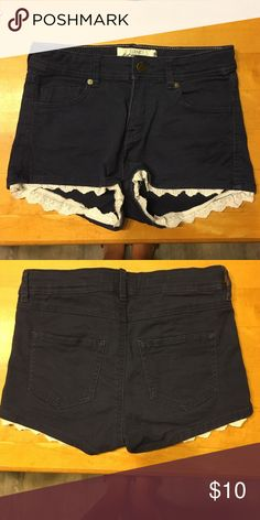 Girls Shorts size 10 Super cute navy blue jean shorts in a girls size 10. Has adorable lace detailing on the ends, great for the summer. Only worn once! H&M Shorts